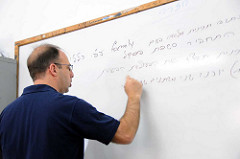 A teacher writing on the board