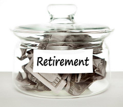 A jar labeled retirement and filled with dollar bills