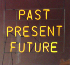 Neon lights that say Past Present Future