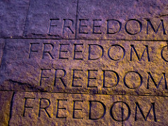 The word freedom etched in stone four times.