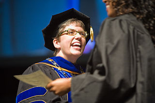 A woman in a graduation gown