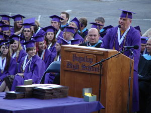 A person delivering a high school graduation speech