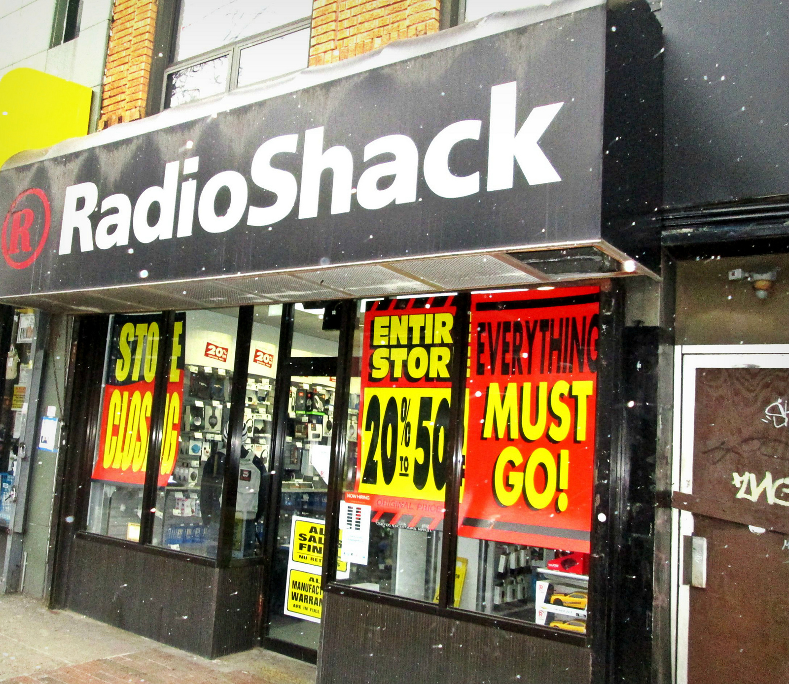 "RadioShack Storefront covered with signs that read, ""Everything must go!"""