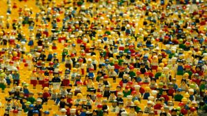 Photo of many many many brightly colored LEGO people.