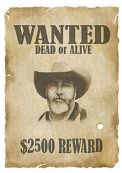 """""""Wanted Dead or Alive"""" poster with a man wearing a cowboy hat"""