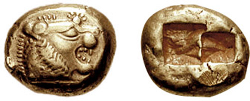 front and back side of an electrum coin. Front has a lion head; reverse has two square imprints, probably to standardize the coin's weight.