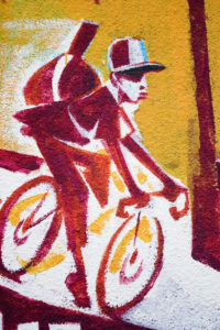 Painting of a bike courier