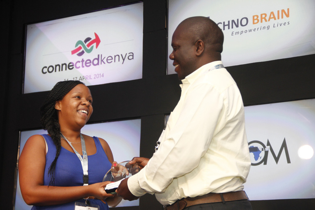 One person handing an award to another.