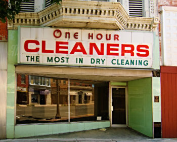 Photo of the front of an old dry-cleaning shop.
