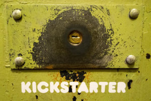 Photo of the Kickstarter Headquarters door lock: a green keyhole with the word KICKSTARTER printed in white underneath.