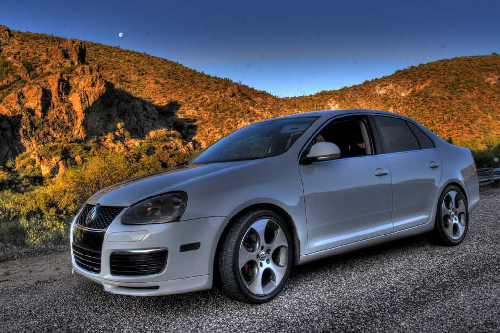Volkswagon Jetta parked in the desert.