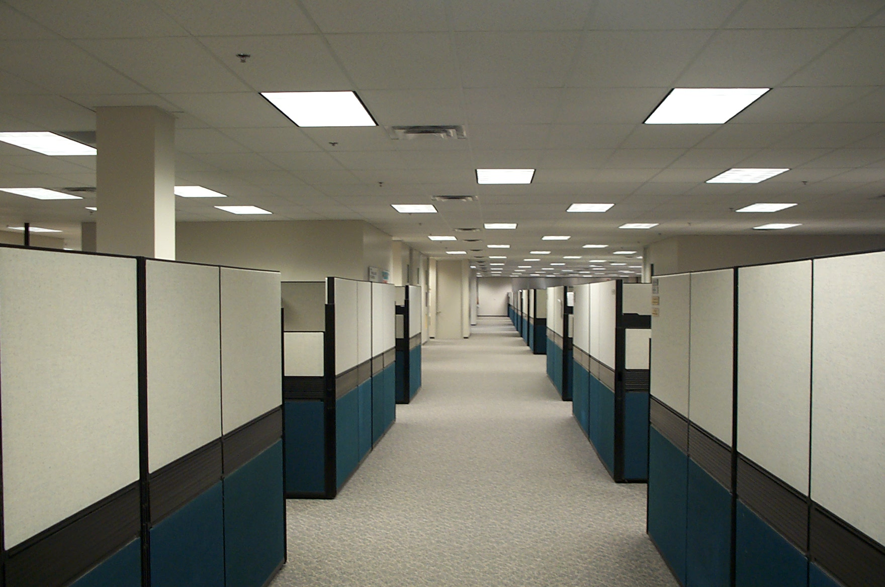 an empty office with rows of cubicles