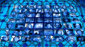 Images shows the faint lines of an organizational chart superimposed on a collage of photos showing different people. The work resembles a stained-glass window, with backlit blue and black shapes.