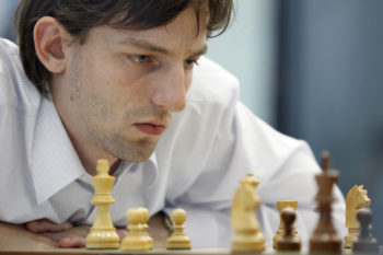 Photo of a chess master, contemplating his next move.