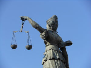 Statue of woman holding the scales of justice.