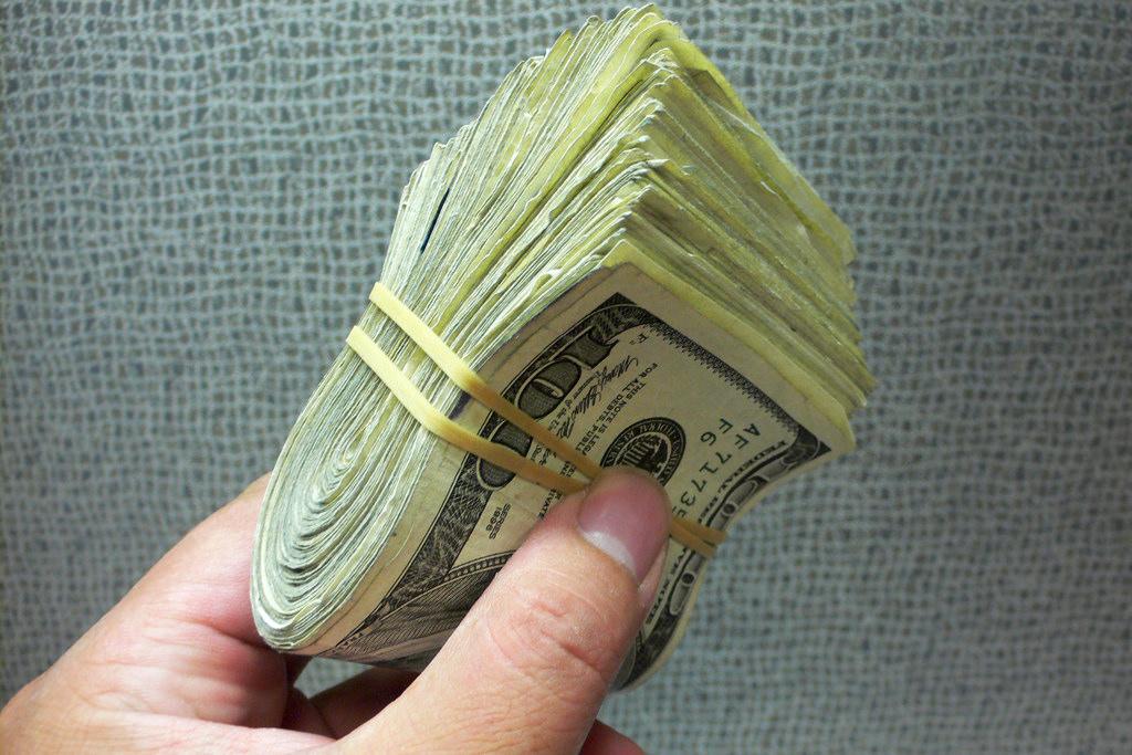 large bundle of 100 dollar bills