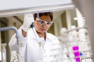 A chemist studies a sample of textile dye.