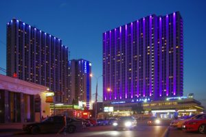 Photo of the Izmailovo Hotel complex at night.