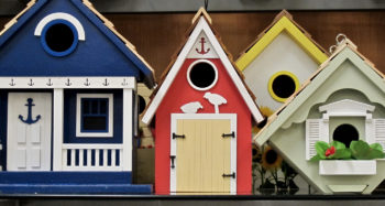 Three different, ornate, brightly colored birdhouses.