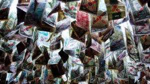 Photo of many different kinds of currency hanging from a ceiling.
