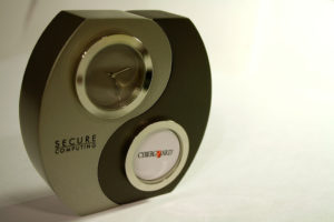 Photo of a clock with a yin yang pattern on the front. One section is labeled Secure Computing; the other section is labeled CyberGuard. Secure Computing acquired CyberGuard.
