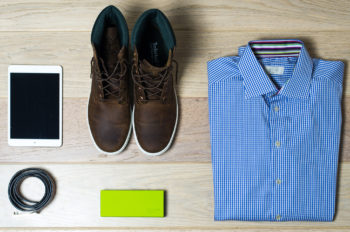Photo of products: a pair of men's shoes, a folded blue men's shirt, an iPad.