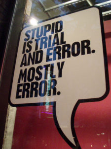 "Sign in window reading ""Stupid is trial and error. Mostly error."""