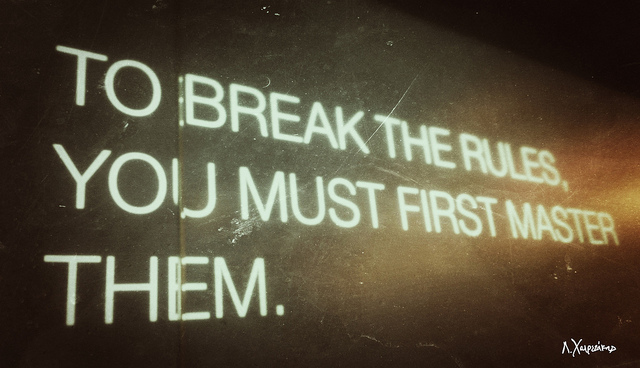 Slogan printed on a wall: To break the rules, you must first master them.