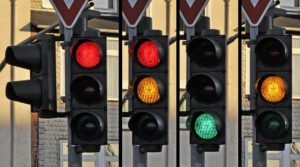 photograph of four traffic lights.