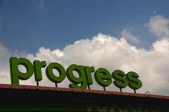 Progress sign on building