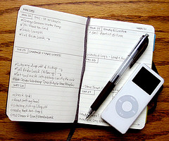 Planner with pen and iPod