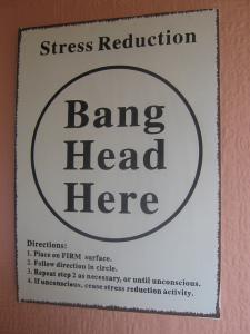 Stress reduction wall sign--bang head here