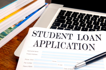 A student loan application, laying on a computer keyboard