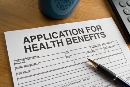 A health benefits application on a desk