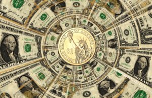 Arrangement of US currency in a circular pattern with a Statue of Liberty dollar coin in the center and one-dollar bills radiating outward from it.