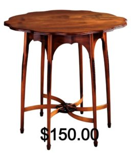 Small wooden table with the price of $150.