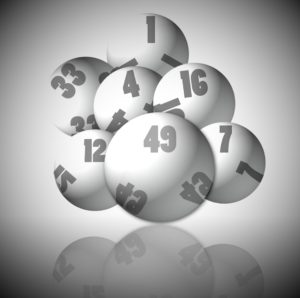 Image shows numbered balls as would be used to select the winning numbers of a lottery.