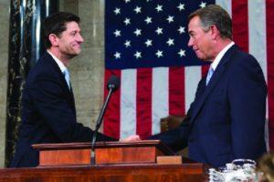 An image of John Boehner shaking hands with Paul Ryan.