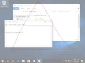 Image of a Windows 10 Desktop with two individual windows open. One is a file finder and the other is a textbook. In front of them both is a large red triangle, indicating that there is a screenshot using the snipping tool in progress.