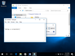 Image of a Windows 10 Desktop with two individual windows open. One is a file finder and the other is a textbook. A screen grab is in progress.
