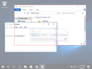 Image of a Windows 10 Desktop with two individual windows open. One is a file finder and the other is a textbook. In front of the file finder is a large red box, indicating that there is a screenshot using the snipping tool in progress specifically on the file finder.
