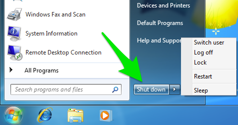 Start menu with green arrow pointing at the shut down button on Windows 7.