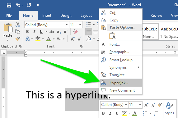 """A Microsoft Word document is open with one sentence of text on it. The last word in the sentence has been double clicked which has lead to a new dropdown menu. There is a large green arrow pointing to a feature on the dropdown menu labeled """"Hyperlink""""."""