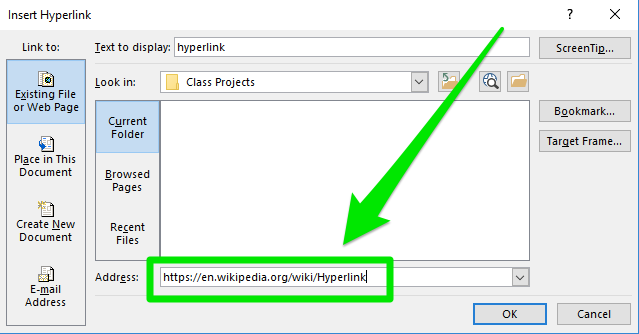 """A hyperlink dialog box is open on display. There is a large green arrow pointing at a green box which is highlighting where the """"Address"""" is going to on the hyperlink."""