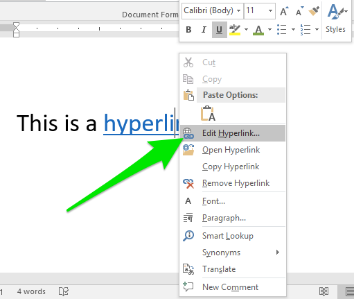 """A sentence that has a blue hyperlink inserted on the last word. A green arrow is pointing to a new dropdown menu that came from the hyperlink. The arrow is pointing at the option to """"Edit Hyperlink""""."""