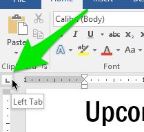 A green arrow pointing towards the left tab option on the ribbon.