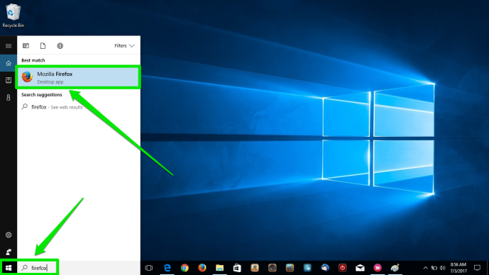 The desktop of a Windows 10 is displayed. There are two green arrows pointing at the windows button on the desktop as well as the search box. The second arrow is pointing at the Mozilla Firefox icon in the newly opened menu.