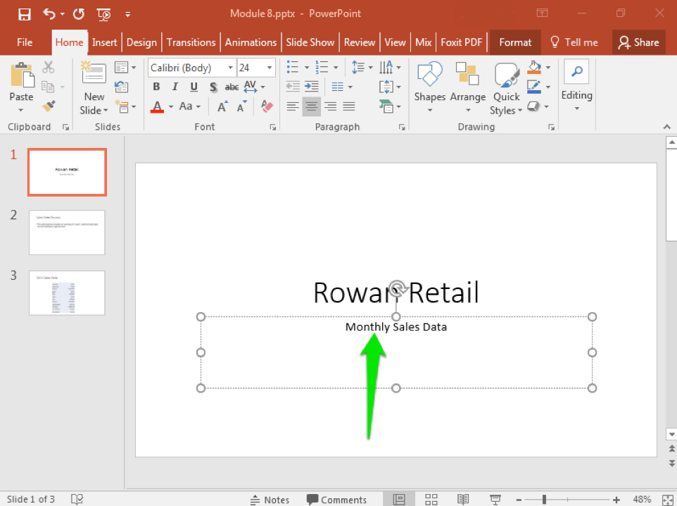 "A Microsoft Powerpoint deck is open with 3 slides created. It is on the title slide and there is a green arrow pointing at the active text box, specifically at the location of the cursor. The text reads ""Monthly Sales Data""."