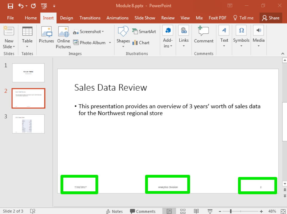 """A Microsoft Powerpoint deck is open with 3 slides created. There are three green boxes on the bottom of the slide showing where the newly inserted options from the header and footer menu are. The box in the bottom left shows the date, the box in the middle shows that the footer has been set to """"Analytics Division"""" and the box on the right shows the page number."""