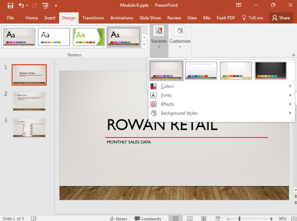 A Microsoft Powerpoint deck is open with 3 slides created. A new design feature has been added making the slide deck more visually appealing. A dropdown menu has emerged from the variants section under the design tab in the ribbon menu.